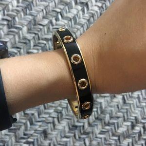 Coach bracelet - Black and gold w/ cutouts